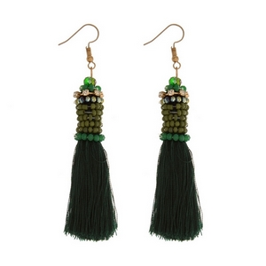 "Gold tone fishhook earrings with a thread tassel and bead-wrapped detail. Approximately 4"" in length."