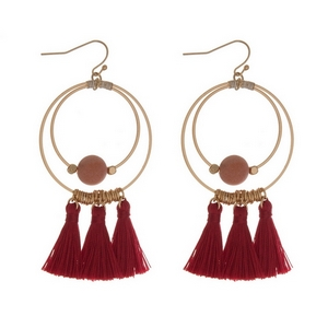 """Gold tone fishhook earrings with an open circle shape, natural stone beads and thread tassels. Approximately 3"""" in length."""