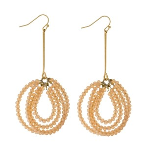 "Gold tone fishhook earrings with a two row, beaded teardrop shape. Approximately 3"" in length."