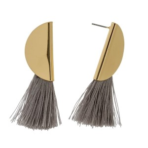 "Gold tone stud earrings with a half circle shape and a thread tassel. Approximately 2"" in length."