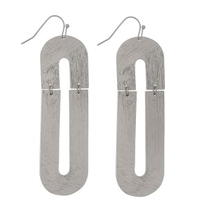 """Gold tone fishhook earrings with an oval shape and a brushed texture. Approximately 3"""" in length."""