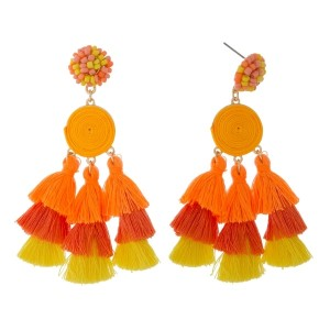 "Beaded stud earrings with ombre thread tassels. Approximately 3"" in length."