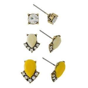 Dainty, three pair earring set with rhinestone and epoxy studs.