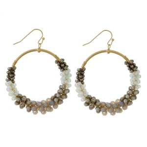 """Gold tone post earrings with an open circle shape and wire-wrapped, two tone beading. Approximately 2.5"""" in length."""