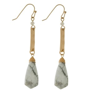 """Gold tone fishhook earrings with a faceted natural stone. Approximately 3"""" in length."""