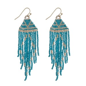 """Gold tone, fishhook earrings with a triangle shape and beaded tassel. Approximately 3.5"""" in length."""