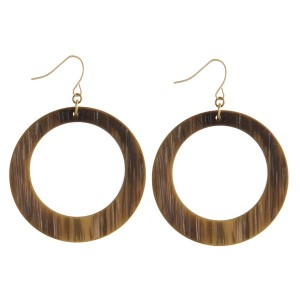 "Gold tone fishhook earrings with an acetate, circle shape. Approximately 2"" in length."