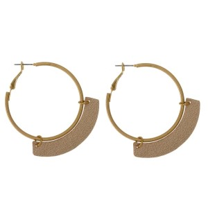 """Gold tone hoop earrings with a leather circle shape. Approximately 1.5"""" in length."""