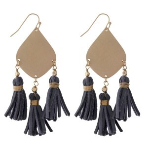 Gold tone fishhook earring with leather tassels. Approximately 2.25' in length.