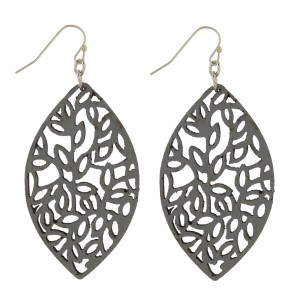 "Silver tone fishhook earring with leather cutout design. Approximately 2"" in length."