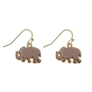 "Gold tone fishhook earring with blush druzy elephant shape. Approximately 1"" in size"