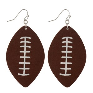 """Fishhook faux leather football earring. Approximately 2"""" in length."""