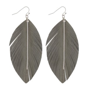 "Genuine leather feather earring with metal detail. Approximately 3"" in length."
