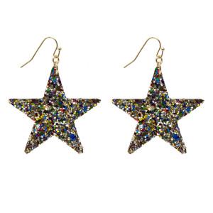 """Fishhook glitter star earring. Approximately 1.25"""" in length."""