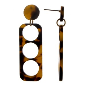 Long acetate earring with circle details.
