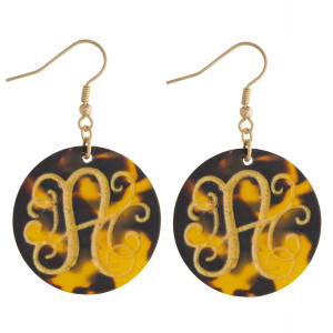 Round fish hook monogram earrings.