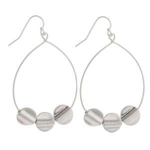 "Gorgeous metal fishhook hoop earrings with little charms along the hoop. Approximate 2"" in diameter."