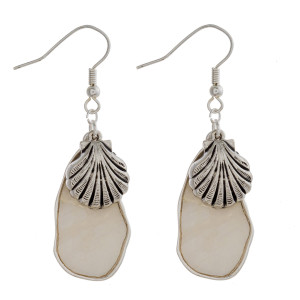 """Fishhook Mother of Pearl earrings with seashell charms. Approximately 2"""" in length."""
