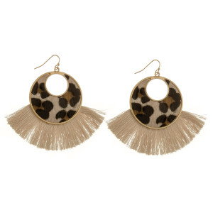"""Long solid hoop earrings with animal print detail and tassel. Approximate 2.5"""" in length."""