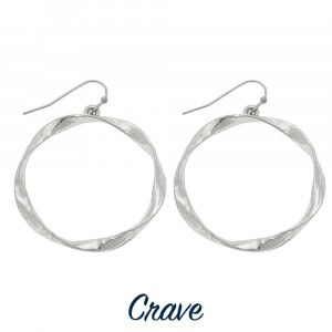 "Hammered metal circle earrings. Approximately 1.25"" in diameter."