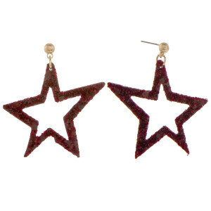 "Gorgeous leather star glitter earrings. Approximate 2"" in length."