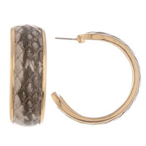 """Long metal hoop earrings with snakeskin details. Approximate 1.5"""" in length."""