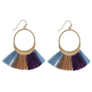 """Long metal hoop raffia detail earrings. Approximate 2.5"""" in length."""