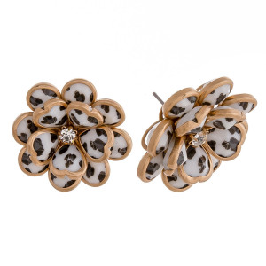 "Leopard print metal flower stud earrings featuring a rhinestone center detail. Approximately .75"" in diameter."