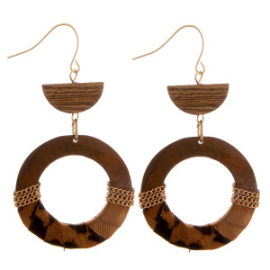 "Long wooden hoop earrings with animal print fabric centered details. Approximate 2.5"" in length."