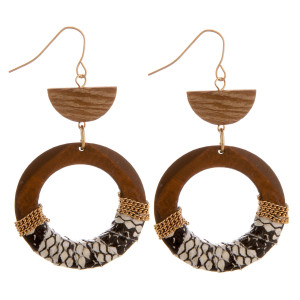 "Long wooden hoop earrings with snake skin centered details. Approximate 2.5"" in length."