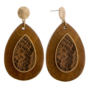 "Long wooden drop earrings with snakeskin raised details. Approximately 2.5"" in length."