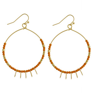"""Long hoop metal earring with bead details and charms. Approximate 2"""" in length."""
