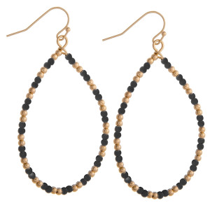 "Black beaded teardrop earrings featuring gold accents. Measures approximately 2"" in diameter."