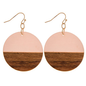"Circular drop earrings featuring wood and resin accents. Measures approximately 1.5"" in diameter."