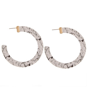 "Wood hoop earrings featuring a white howlite inspired pattern. Measure approximately 2.5"" in diameter."