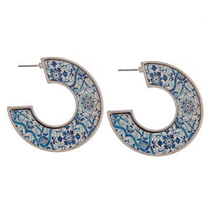 """Open hoop metal earrings featuring a wood inspired detailed pattern with a stud post. Approximately 1.5"""" in diameter."""