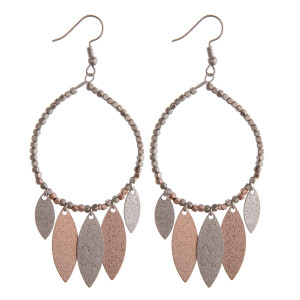 "Two tone circular earrings featuring beaded details and hanging accents. Approximately 3"" in length."