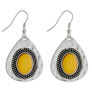 """Teardrop earrings featuring a yellow natural stone and hammered metal details. Approximately 1"""" in length."""