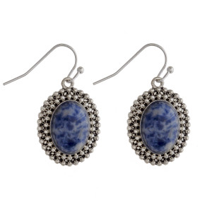 """Drop earrings featuring a dark blue natural stone and metal beaded details. Approximately 1"""" in length."""