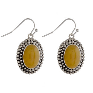 """Drop earrings featuring a yellow natural stone and metal beaded details. Approximately 1"""" in length."""