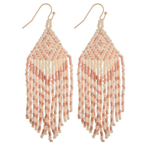 "Long pink boho beaded earrings. Measures approximately 2.75"" long."