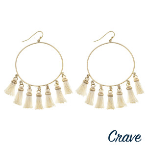 "Circular drop earrings featuring fanned tassel details with gold metal accents. Approximately 1.75"" in diameter. Approximately 3"" in length overall."