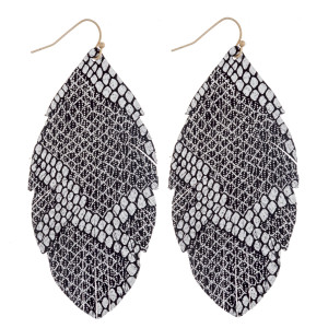 "Long feather inspired faux leather earrings featuring metallic snakeskin details. Approximately 3"" in length."