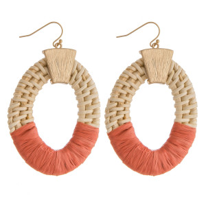 """Large rattan woven earrings featuring raffia wrapped details and a gold accent. Approximately 2"""" in length."""