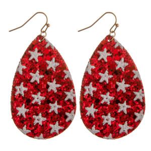 "Long, glitter teardrop earrings featuring star details. Approximately 2"" in length."