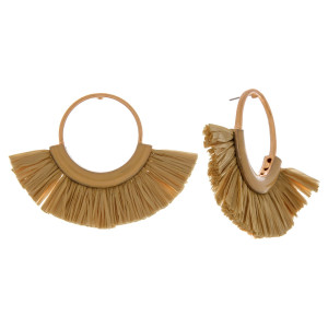 """Circular metal earrings featuring enamel and raffia tassel details with a stud post. Approximately 2"""" in length."""