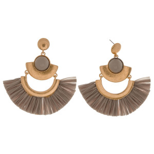 "Metal drop earrings featuring raffia tassel details and a enamel inspired stone accent. Approximately 3"" in length."