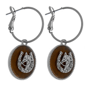 """Dainty hoop earrings featuring a faux leather accent with horseshoe details. Approximately 2"""" in length."""