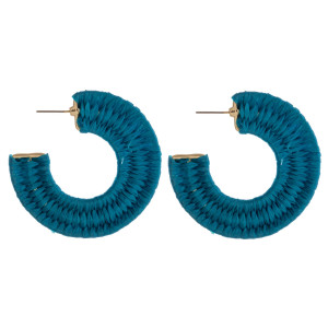 "Raffia wrapped open hoop earrings featuring a stud post. Approximately 2"" in diameter."