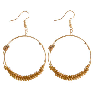 """Circular metal drop earrings featuring iridescent beaded details with multi stands and gold accents. Approximately 2.5"""" in length."""